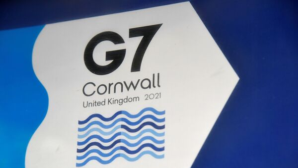 A G7 logo is seen on an information sign near the Carbis Bay hotel resort, where an in-person G7 summit of global leaders is due to take place in June, St Ives, Cornwall, southwest Britain May 24, 2021. Picture taken May 24, 2021 - Sputnik International