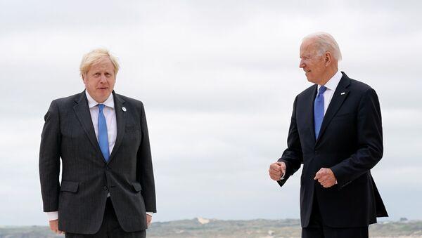 British Prime Minister Boris Johnson and U.S. President Joe Biden pose for photos at the G-7 summit, in Carbis Bay, Cornwall, Britain June 11, 2021 - Sputnik International