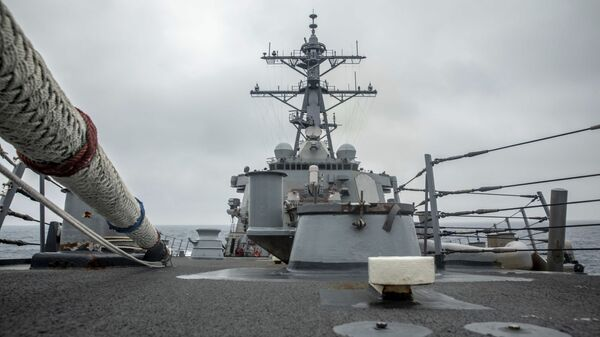 In this photo released by the U.S. Navy, the U.S. Arleigh Burke-class guided-missile destroyer USS Curtis Wilbur (DDG 54) conducts routine operations in the Taiwan Strait, May 18, 2021. - Sputnik International