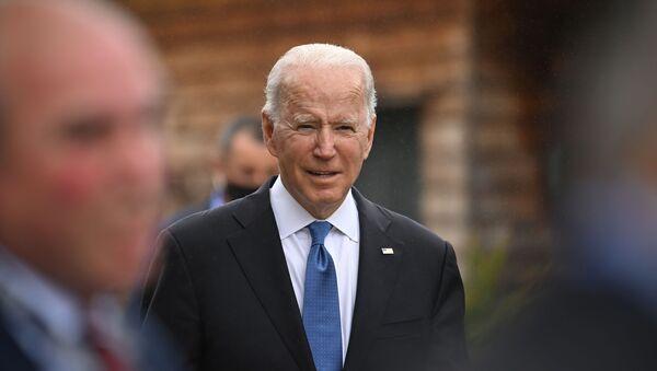 U.S. President Joe Biden walks between engagements at the G7 summit in Carbis Bay, Cornwall, Britain, June 11, 2021.  - Sputnik International