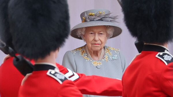 Britain's Queen Elizabeth II watches a military ceremony to mark her official birthday at Windsor Castle on June 12, 2021 in Windsor. - Sputnik International
