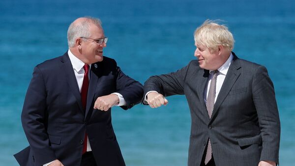 Britain's Prime Minister Boris Johnson greets Australia's Prime Minister Scott Morrison during an official welcome at the G7 summit in Carbis Bay, Cornwall, Britain, 12 June 2021.  - Sputnik International