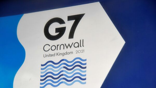 A G7 logo is seen on an information sign near the Carbis Bay hotel resort, where an in-person G7 summit of global leaders is due to take place in June, St Ives, Cornwall, southwest Britain May 24, 2021. Picture taken May 24, 2021.  - Sputnik International