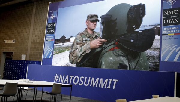 NATO troops are shown on a large screen in an empty press room at NATO headquarters prior to a NATO summit in Brussels, Sunday, June 13, 2021. - Sputnik International