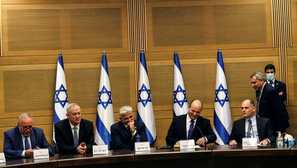 Israeli Prime Minister Naftali Bennett and some of his government attend its first cabinet meeting in the Knesset, Israel's parliament, in Jerusalem June 13, 2021. - Sputnik International