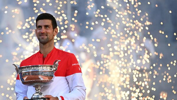 Serbia's Novak Djokovic poses with The Mousquetaires Cup (The Musketeers) after winning against Greece's Stefanos Tsitsipas at the end of their men's final tennis match on Day 15 of The Roland Garros 2021 French Open tennis tournament in Paris on June 13, 2021. - Sputnik International