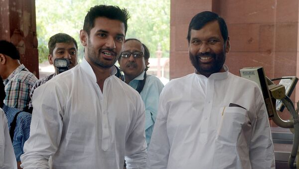 Newly elected Indian Minister of Consumer Affairs, Food and Public Distribution, Ramvilas Paswan (R) and his son, newly elected Member of Parliament (MP) Chirag Paswan arrive for the first session of India's newly elected parliament in New Delhi on June 4, 2014. - Sputnik International