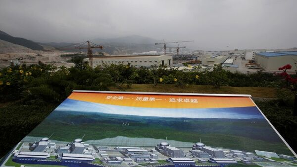 An artist impression of Taishan Nuclear Power Plant, to be operated by China Guangdong Nuclear Power (CGN), is displayed on a viewing platform overlooking the construction site in Taishan, Guangdong province, October 17, 2013.  REUTERS/Bobby Yip/File Photo - Sputnik International