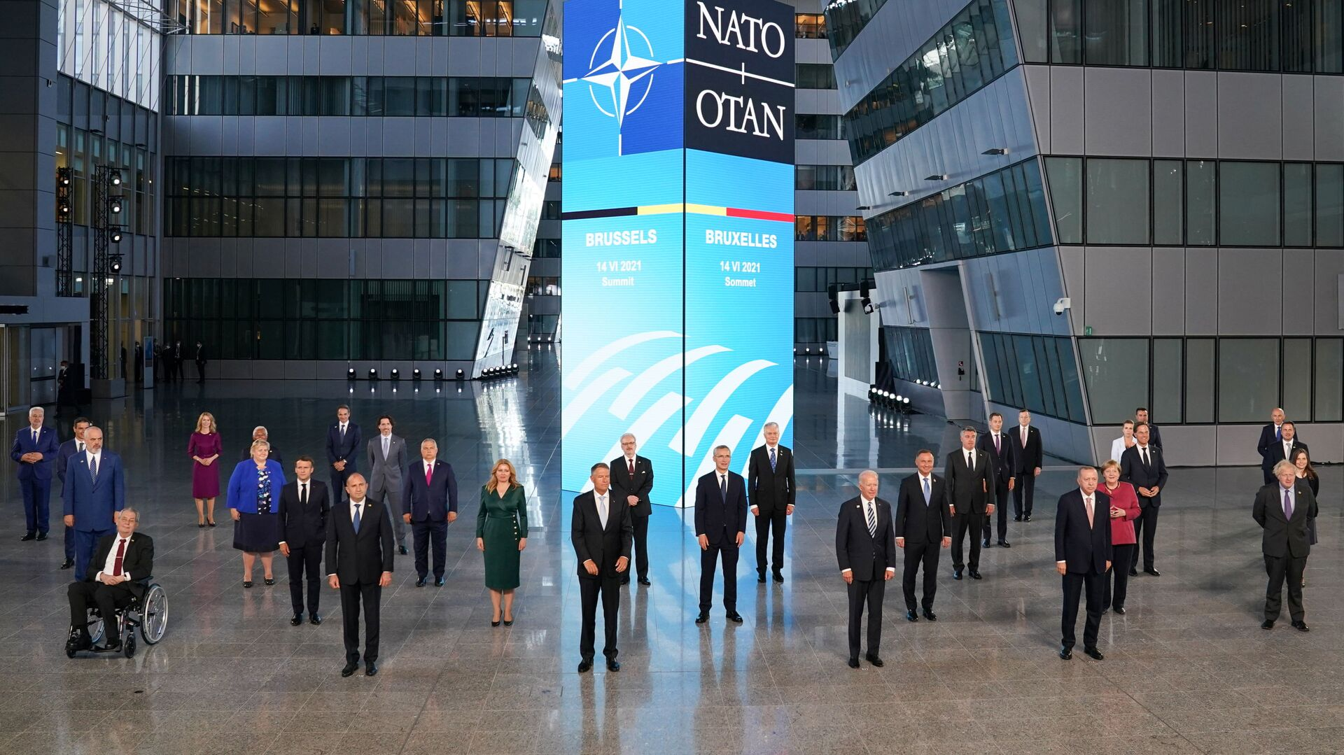 U.S. President Joe Biden and other NATO heads of the states and governments pose for a family photo during the NATO summit at the Alliance's headquarters, in Brussels, Belgium June 14, 2021. REUTERS/Kevin Lamarque/Pool - Sputnik International, 1920, 19.08.2021
