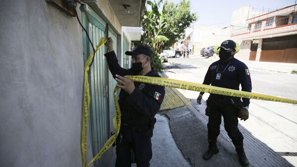 A police officer marks a security perimeter around the house where bones were found under the floor in the Atizapan municipality of the State of Mexico, Thursday, May 20, 2021. Police have turned up bones and other evidence under the floor of the house where a man was arrested for allegedly stabbing a woman to death and hacking up her body.  - Sputnik International