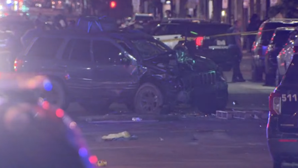 A mangled vehicle sits in the road after ramming into another car outside a protest for Winston Smith, a Black man killed by US Marshals, in Minneapolis, Minnesota on June 13, 2021. - Sputnik International