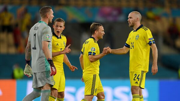 Sweden's Marcus Danielson celebrate with teammates after the match Spain v Sweden, La Cartuja, Seville, Spain, June 14, 2021 - Sputnik International