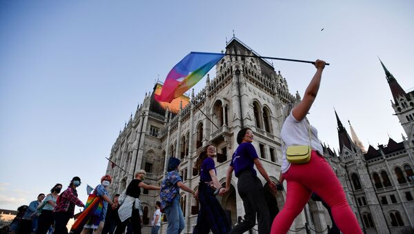 Demonstrators march as they protest against Hungarian Prime Minister Viktor Orban and the latest anti-LGBTQ law in Budapest, Hungary, June 14, 2021 - Sputnik International