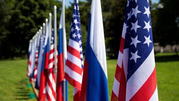 Flags of the U.S., Russia and Switzerland are pictured in the garden in front of villa La Grange, one day prior to the meeting of U.S. President Joe Biden and Russian President Vladimir Putin in Geneva, Switzerland - Sputnik International