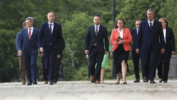 DUP leader Edwin Poots (far right) and the new First Minister Paul Givan (second from left) arrive at Stormont - Sputnik International