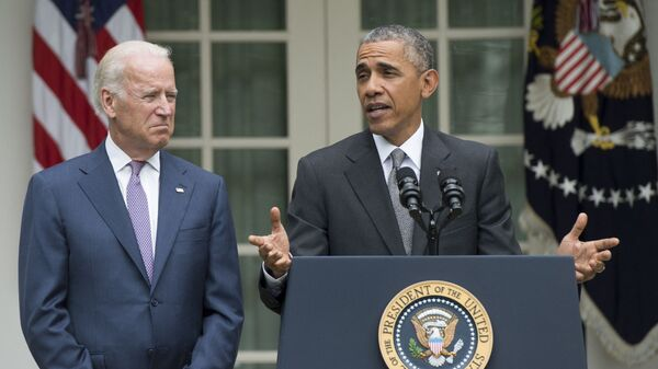 US President Barack Obama speaks alongside US Vice President Joe Biden about the Supreme Court's ruling to uphold the subsidies that comprise the Affordable Care Act, known as Obamacare, in the Rose Garden of the White House in Washington, DC, June 25, 2015 - Sputnik International