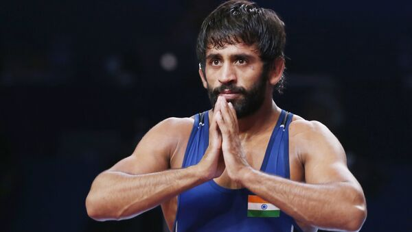Bajrang Punia of India reacts as he won the bronze match of the men's 65kg category against Tulga Tumur Ochir of Mongolia during the Wrestling World Championships in Nur-Sultan, Kazakhstan, Friday, Sept. 20, 2019 - Sputnik International