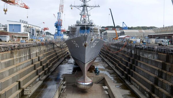 The guided-missile destroyer USS John S. McCain is in dry dock at Fleet Activities Yokosuka during a scheduled dry-dock selective restricted availability. John S. McCain is one of seven ships assigned to Destroyer Squadron 15 and is permanently forward-deployed to Yokosuka, Japan. - Sputnik International