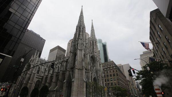 Pedestrians pass St Patrick's Cathedral Wednesday, July 8, 2020, in New York. - Sputnik International
