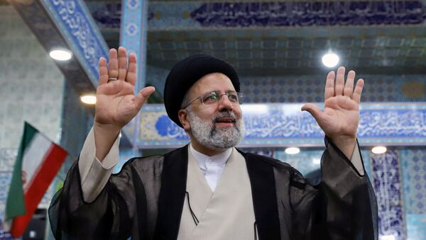 Presidential candidate Ebrahim Raisi gestures after casting his vote during presidential elections at a polling station in Tehran, Iran June 18, 2021. Majid Asgaripour/WANA (West Asia News Agency) - Sputnik International