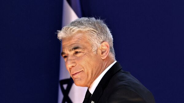 Israeli alternate Prime Minister and Foreign Minister Yair Lapid arrives for a photo at the President's residence during a ceremony for the new coalition government in Jerusalem, on June 14, 2021. - A motley alliance of Israeli parties on June 13 ended Benjamin Netanyahu's 12 straight years as prime minister, as parliament voted in a new government led by his former ally, right-wing Jewish nationalist Naftali Bennett. - Sputnik International