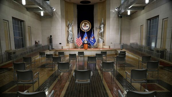 Empty chairs are arranged for social distancing, ahead of U.S. Attorney General Merrick Garland's remarks on voting rights, inside the Great Hall at the U.S. Department of Justice in Washington, U.S., June 11, 2021. - Sputnik International