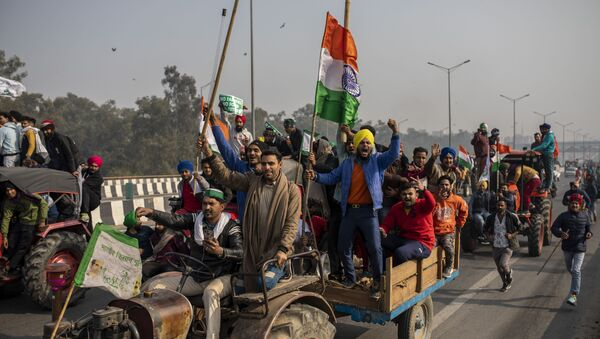 FILE - In this Jan. 26, 2021 file photo, protesting farmers ride tractors and shout slogans as they march to the capital breaking police barricades during India's Republic Day celebrations in New Delhi, India - Sputnik International