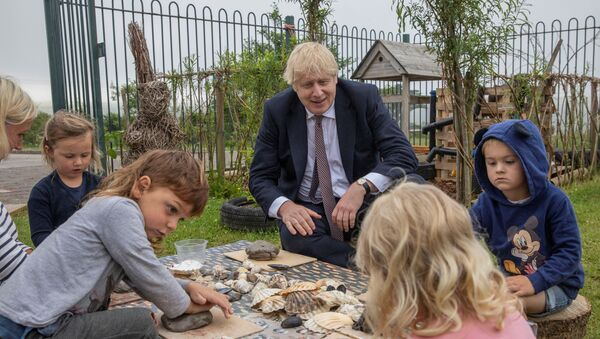Prime Minister Boris Johnson visits the out door spaces to discuss environmental issues at the St Issey Primary school near Wadebridge in Cornwall. - Sputnik International