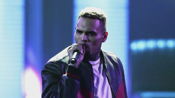 In this June 25, 2017, file photo, Chris Brown performs at the BET Awards at the Microsoft Theater in Los Angeles. Brown says he's having a high-end yard sale at his Los Angeles home, and a crowd has been gathering for hours.  - Sputnik International