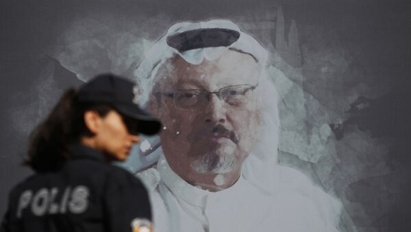 In this Wednesday, Oct. 2, 2019 file photo, a Turkish police officer walks past a picture of slain Saudi journalist Jamal Khashoggi prior to a ceremony, near the Saudi Arabia consulate in Istanbul, marking the one-year anniversary of his death. - Sputnik International