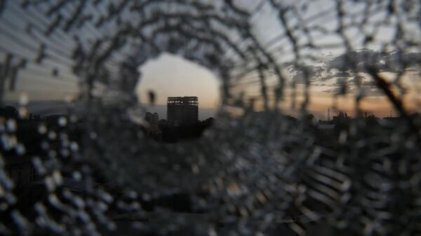 A building is seen through a bullet hole in a window of the Africa Hotel in the town of Shire, Tigray region, Ethiopia, March 16, 2021. Picture taken March 16, 2021 - Sputnik International