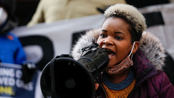 FILE PHOTO: Community activist India Walton speaks through a megaphone as she campaigns to replace four-term Mayor Byron Brown, in Buffalo, New York, U.S., December 15, 2020.  - Sputnik International