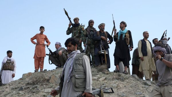 Armed men attend a gathering to announce their support for Afghan security forces and that they are ready to fight against the Taliban, on the outskirts of Kabul, Afghanistan June 23, 2021 - Sputnik International
