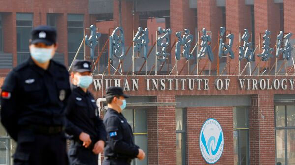Security personnel keep watch outside the Wuhan Institute of Virology during the visit by the World Health Organization (WHO) team tasked with investigating the origins of the coronavirus disease (COVID-19), inWuhan, Hubei province, China February 3, 2021.  - Sputnik International