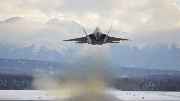 An Air Force F-22 Raptor assigned to the 3rd Wing flies over Joint Base Elmendorf-Richardson, Alaska, Feb. 27, 2018. - Sputnik International