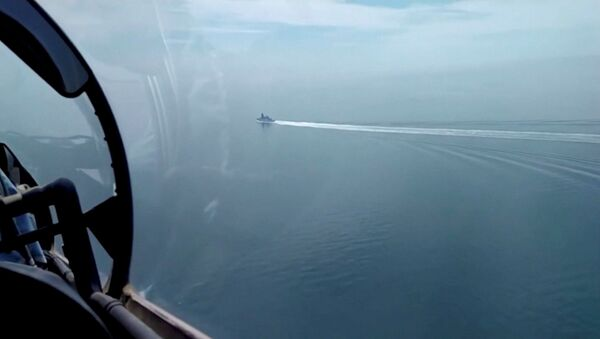 A still image taken from a video released by Russia's Defence Ministry allegedly shows British Royal Navy's Type 45 destroyer HMS Defender filmed from a Russian military aircraft in the Black Sea, June 23, 2021. - Sputnik International