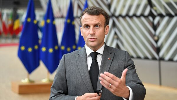 France's President Emmanuel Macron addresses the media as he arrives on the first day of the European Union summit at The European Council Building in Brussels, Belgium June 24, 2021. - Sputnik International