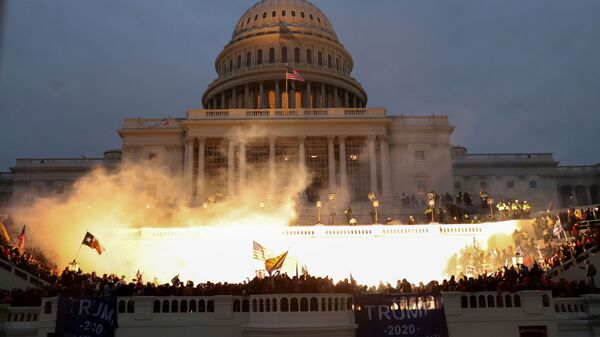 An explosion caused by a police munition is seen while supporters of U.S. President Donald Trump gather in front of the U.S. Capitol Building in Washington, U.S., January 6, 2021. - Sputnik International