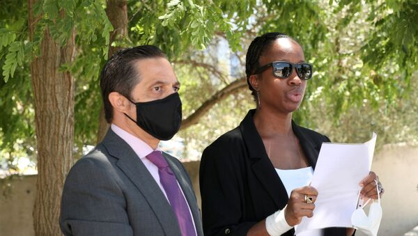 Janice McAfee, a wife of John McAfee, flanked by her lawyer Javier Villalba, speaks to media as she leaves the Brians 2 prison where her husband was found dead in his prison cell after the Spanish high court had authorised his extradition to the U.S., in Sant Esteve Sesrovires, Spain June 25, 2021. - Sputnik International