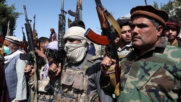 Armed men attend a gathering to announce their support for Afghan security forces and that they are ready to fight against the Taliban, on the outskirts of Kabul, Afghanistan June 23, 2021. - Sputnik International