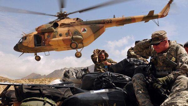 Humanitarian Aid Delivered to Afghan Village by NATO Training Mission-Afghanistan  - Sputnik International