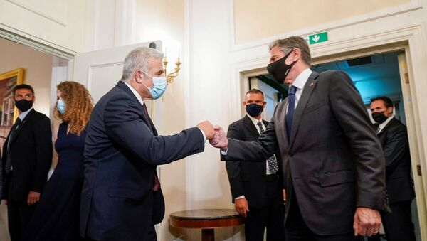 U.S. Secretary of State Antony Blinken greets Israeli Foreign Minister Yair Lapid during their meeting in Rome, Italy, June 27, 2021. - Sputnik International