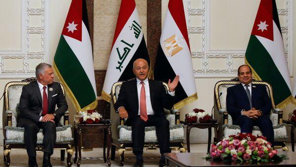 Iraqi President Barham Salih meets with King Abdullah II of Jordan and Egypt's President Abdel Fattah al-Sisi, in Baghdad, Iraq, June 27, 2021. - Sputnik International