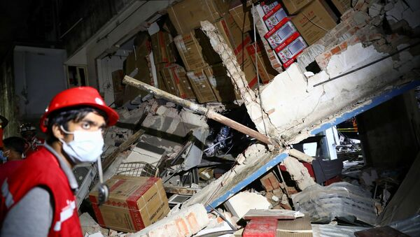 A rescue worker looks on at the site after a blast in a shop that killed several people in Dhaka, Bangladesh, June 27, 2021.  - Sputnik International