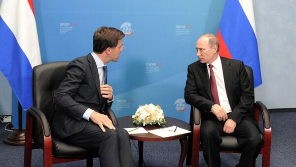 June 20, 2013. Russian President Vladimir Putin, right, and Prime Minister of the Netherlands Mark Rutte at a meeting at the 17th St. Petersburg International Economic Forum at Lenexpo - Sputnik International