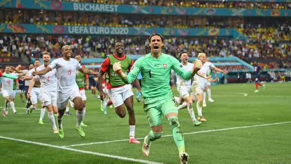 Soccer Football - Euro 2020 - Round of 16 - France v Switzerland - National Arena Bucharest, Bucharest, Romania - June 29, 2021   Switzerland's Yann Sommer celebrates after saving a penalty from France's Kylian Mbappe to win the shoot-out  - Sputnik International
