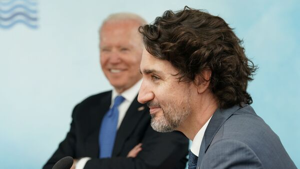 U.S. President Joe Biden and Canada's Prime Minister Justin Trudeau attend a session during the G7 summit in Carbis Bay, Cornwall, Britain, June 11, 2021 - Sputnik International
