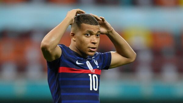 Soccer Football - Euro 2020 - Round of 16 - France v Switzerland - National Arena Bucharest, Bucharest, Romania - June 29, 2021   France's Kylian Mbappe reacts after his shot is saved by Switzerland's Yann Sommer during the penalty shoot-out  - Sputnik International