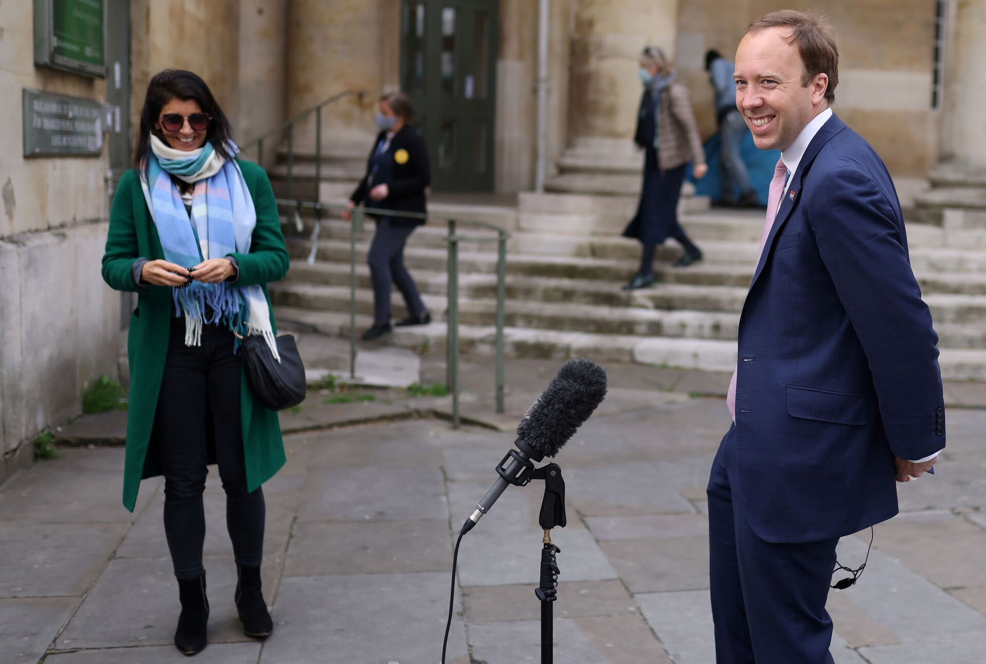 Britain's Health Secretary Matt Hancock smiles during a television interview as his aide Gina Coladangelo looks on, outside BBC's Broadcasting House in London - Sputnik International, 1920, 07.09.2021