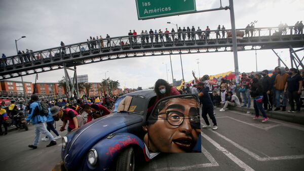 People push a car with the image of late Colombian humorist and journalist Jaime Garzon painted on it during a protest demanding government action to tackle poverty, police violence and inequalities in healthcare and education systems, in Bogota, Colombia,  June 2, 2021. - Sputnik International